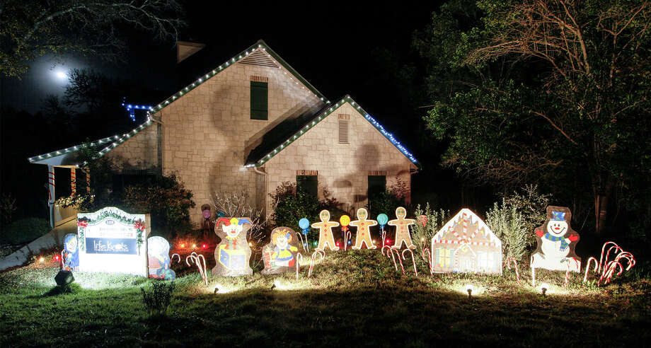 """Braces by Bradley, an office at 123 Medical, took the """"Most Festive"""" award in the Boerne Parade of Lights commercial category for 2013 Photo: Marvin Pfeiffer / Northwest Weekly / Prime Time Newspapers 2013"""