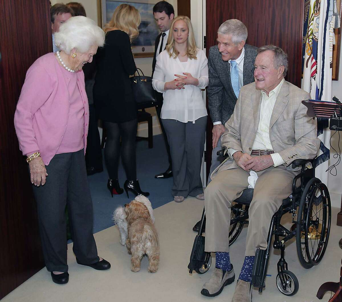 Former First Lady Barbara Bush left, Jim McIngvale and Former President George H. W. Bush, after a ceremony presenting the 5115th Daily Point of Light (DPOL) Award to McIngvale at President Bush's office Monday, Dec. 23, 2013, in Houston.