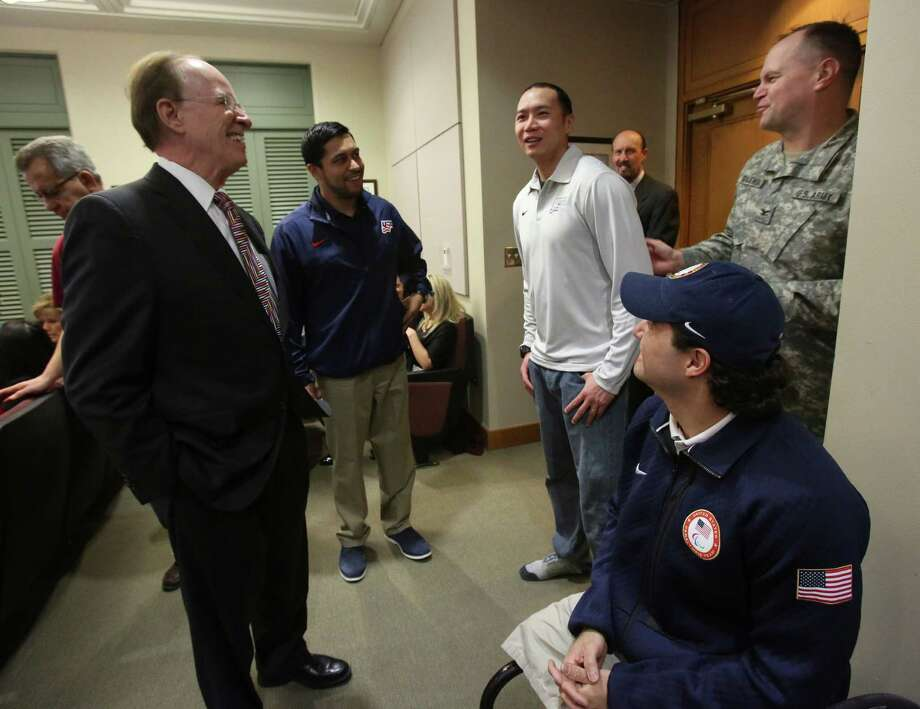 Judge Nelson Wolff speaks with Rico Roman, Staff Sgt. Jen Lee, Col. Donal Gajewski and Josh Sweeney before Commisioners court on Tuesday Dec. 17, 2013. Roman, Lee and Sweeny are three paralympians who will be part of the 17-person U.S. Paralympic Sled Hockey Team that will compete in Sochi, Russia, in 2014. Photo: Helen L. Montoya, San Antonio Express-News / ©2013 San Antonio Express-News