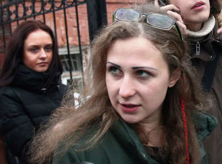 Maria Alekhina, second from left, a member of the Russian punk band Pussy Riot speaks to the media at the Committee against Torture after being released from prison, in Nizhny Novgorod, Russia, Monday, Dec. 23, 2013. Alekhina was released from prison Monday, saying that the amnesty bill that gave her freedom was a Kremlin public relations stunt. Alekhina was one of two band members who were granted amnesty last week, which was largely viewed as the Kremlin's attempt to soothe criticism of Russia's human rights records ahead of the Winter Olympics in Sochi in February. (AP Photo/Filipp Romanov) ORG XMIT: XAZ103 Photo: Filipp Romanov / AP