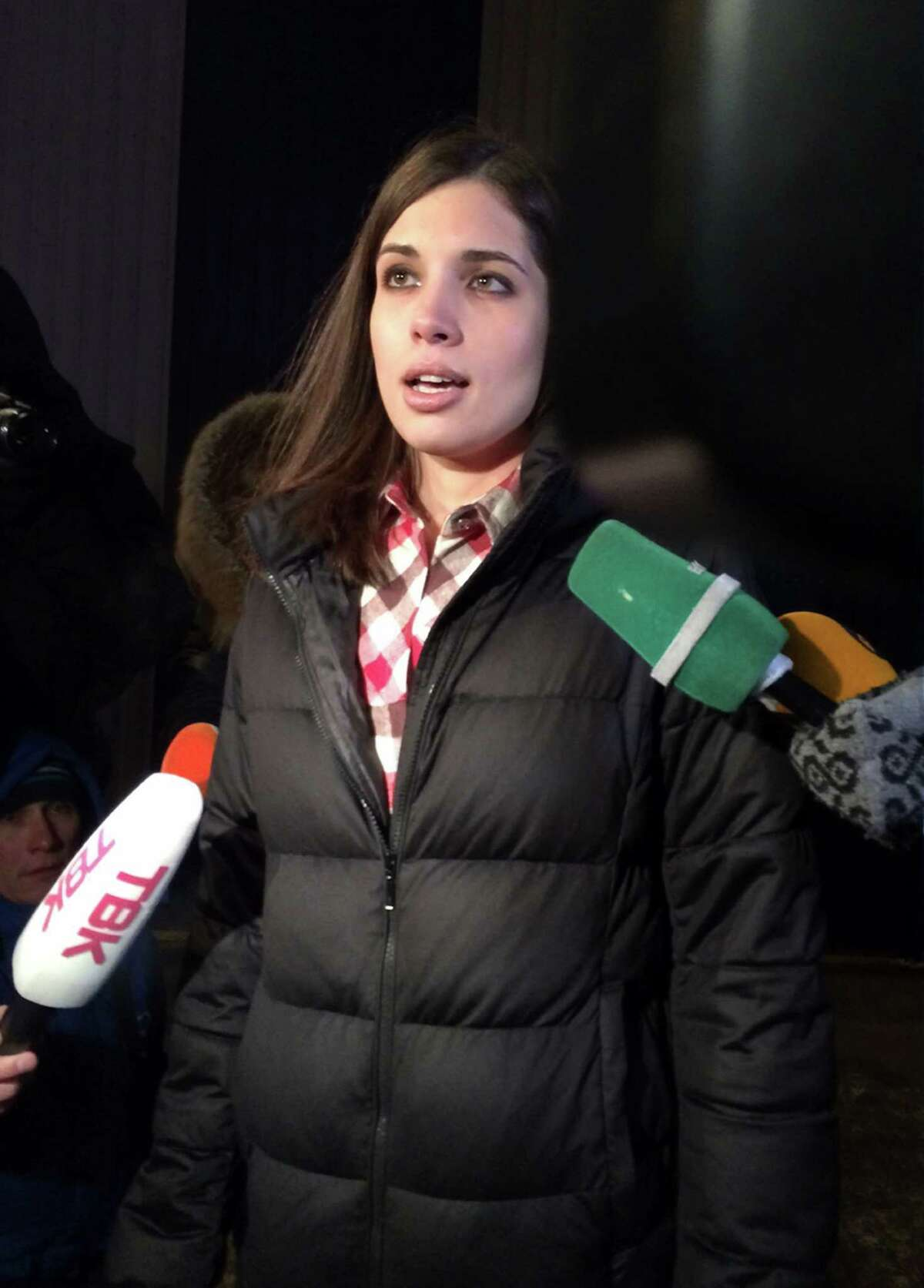 Nadezhda's Tolokonnikova speaks to the media after leaving a prison in Krasnoyarsk, Russia, Monday, Dec. 23, 2013. The third member of the Russian punk bank Pussy Riot has been released from custody following an amnesty law passed by parliament. Tolokonnikova left the prison colony in the eastern Siberian city Krasnoyarsk on Monday, hours after another band member, Maria Alekhina, was released in another region. (AP Photo/Alexander Roslyakov) ORG XMIT: XAZ104