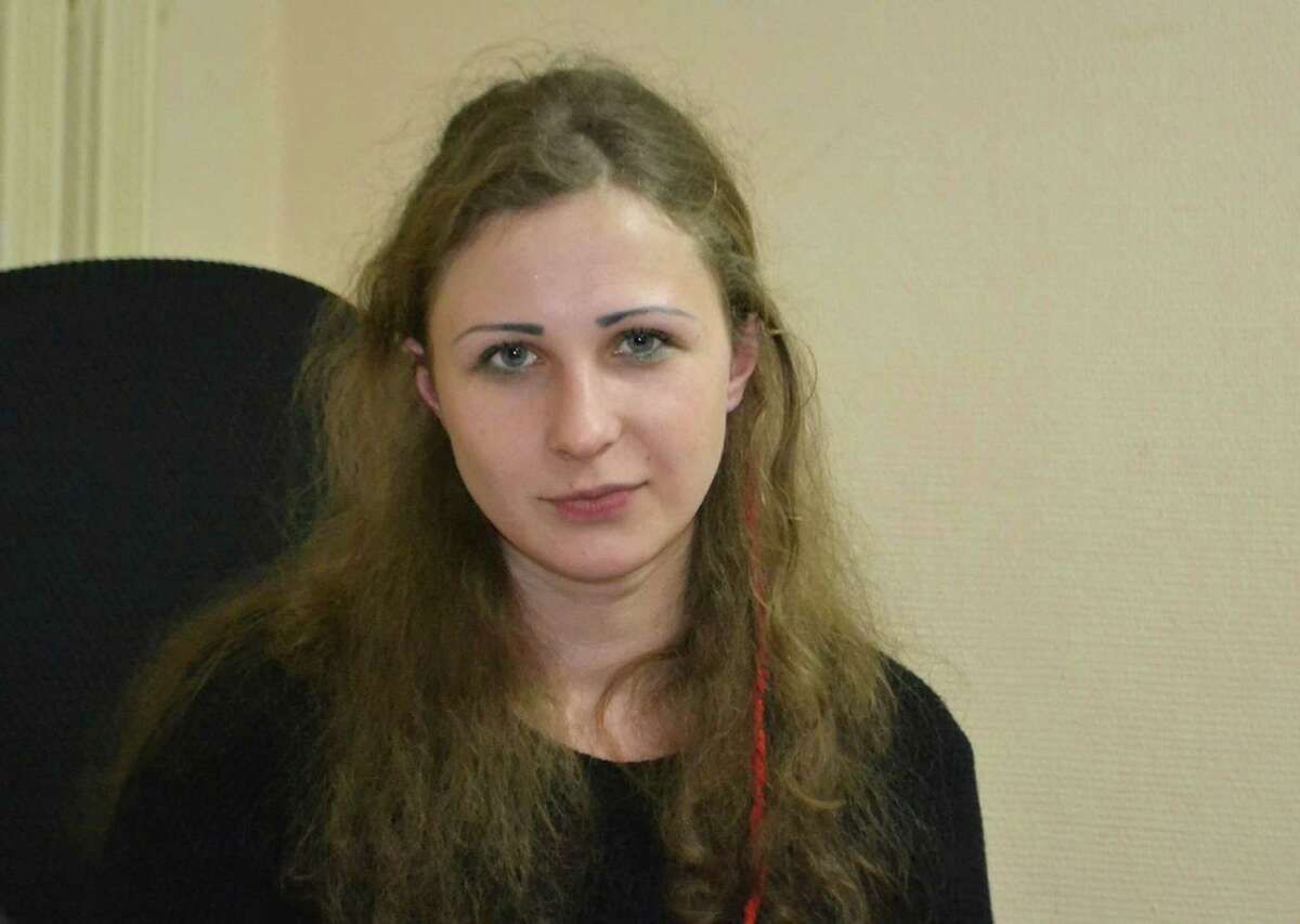 Maria Alekhina, a jailed member of the Russian punk band Pussy Riot, who was found guilty of hooliganism after a performance critical of President Vladimir Putin, poses for a photo in the Committee against Torture as she has been released from prison in Nizhny Novgorod, on Monday, Dec. 23, 2013. Alekhina, and two other band members, Nadezhda Tolokonnikova and Yekaterina Samutsevich, were found guilty of hooliganism motivated by religious hatred and sentenced to two years in prison for the performance at Moscow's main cathedral in March 2012. Samutsevich was released several months later on suspended sentence. (AP Photo/The Committee against Torture) MANDATORY CREDIT ORG XMIT: XAZ101