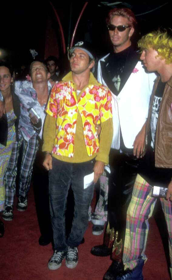 1992: Vedder poses the question visually -- Which is the uglier shirt? Photo: Barry King, Getty Images / WireImage