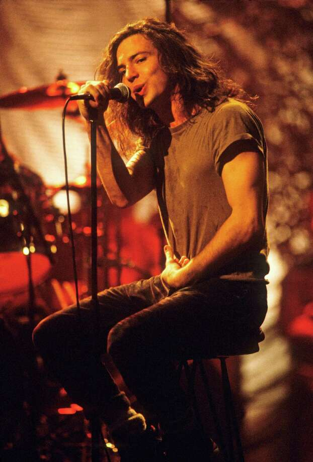 "1992: Vedder, pictured shortly before he started drawing on himself during ""Pearl Jam: MTV Unplugged."" Photo: Kevin Mazur, Getty Images / 2011 Kevin Mazur"