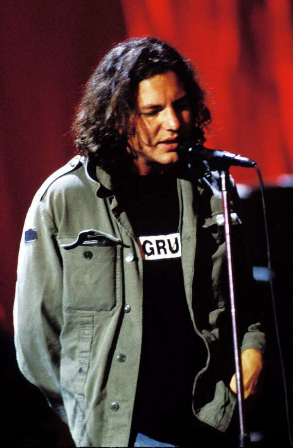"1993: Vedder, wearing a shirt that reads ""Grunge."" Lot going on there, we assume. Photo: Jeff Kravitz, Getty Images / FilmMagic, Inc"