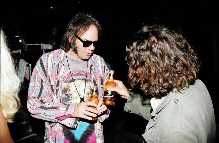 1993: Neil Young and Vedder, drinking MGD. Photo: Jeff Kravitz, Getty Images / FilmMagic, Inc