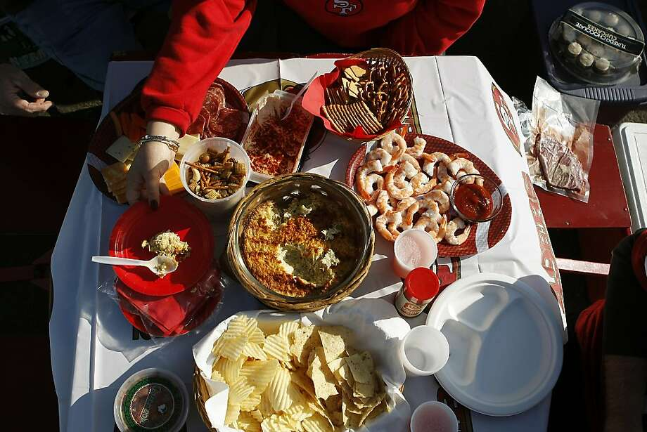 Spreads of food are seen as fans tailgate in the parking lot before the San Francisco 49ers play the Atlanta Falcons during a Monday Night Football game which will be the last regular season game to be held at Candlestick Park in San Francisco, CA, Monday, December 23, 2013. Photo: Michael Short, The Chronicle