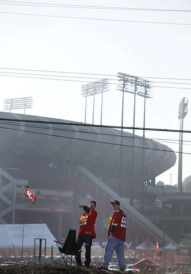 Antonio Hernandez, left, and Jason Judd tailgate on a dirt berm on the north side of Candlestick Park on December 23, 2013 in San Francisco, Calif. Photo: Pete Kiehart, The Chronicle