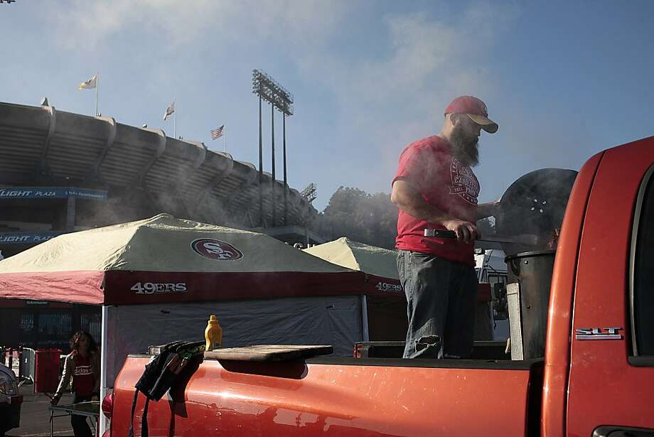 Brian Meidinger cooks BBQ from the bed of his truck outside of Candlestick Park on Monday, Dec. 23, 2013. The San Francisco 49ers hosted the Atlanta Falcons at one of their last games at Candlestick Park. Photo: James Tensuan, Special To The Chronicle