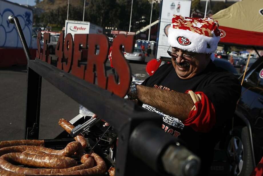 Fred Santillan of Sunnyvale grills sausages as he and friends tailgate before the San Francisco 49ers play the Atlanta Falcons during a Monday Night Football game which will be the last regular season game to be held at Candlestick Park in San Francisco, CA, Monday, December 23, 2013. Photo: Michael Short, The Chronicle