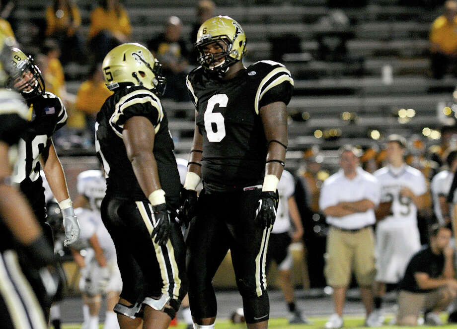 Nederland defensive linemen Caleb Malveaux, left,  and DeShawn Washington during the Bulldog's match up with Vidor on Friday. Photo provided by Brian Vincent