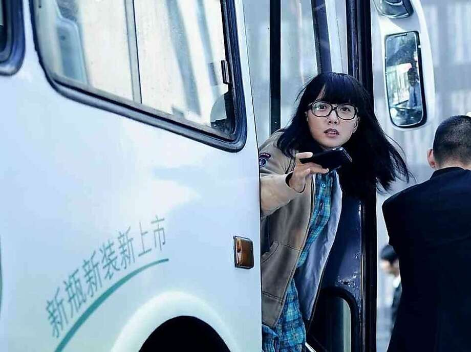 """Luodan-wang stars in """"Caught in the Web,"""" in which a journalist intern in China films a woman's defiance on a bus and the video goes viral, sparking heated responses. The movie opens Friday. Photo: LevelFilms"""