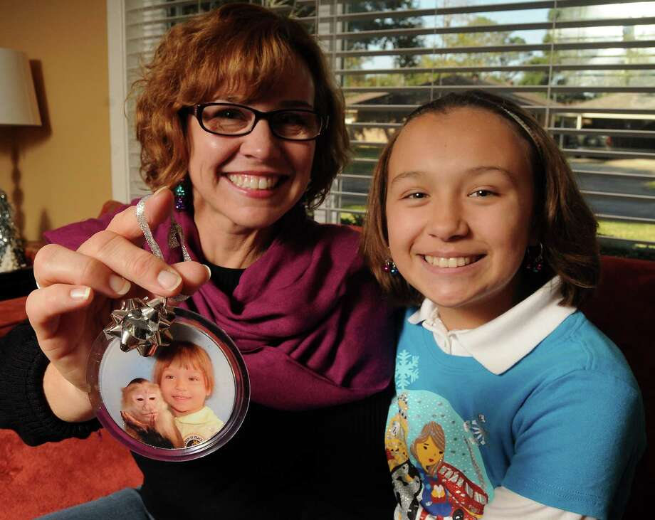Elizabeth Bandercan and her daughter Grace, 12, show the ornament they've come to love because it's so bizarre. Photo: Dave Rossman, Freelance / © 2013 Dave Rossman