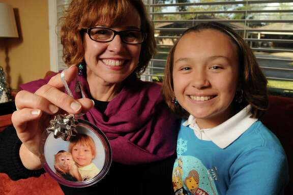 Elizabeth Bandercan and her daughter Grace, 12, show the ornament they've come to love because it's so bizarre.