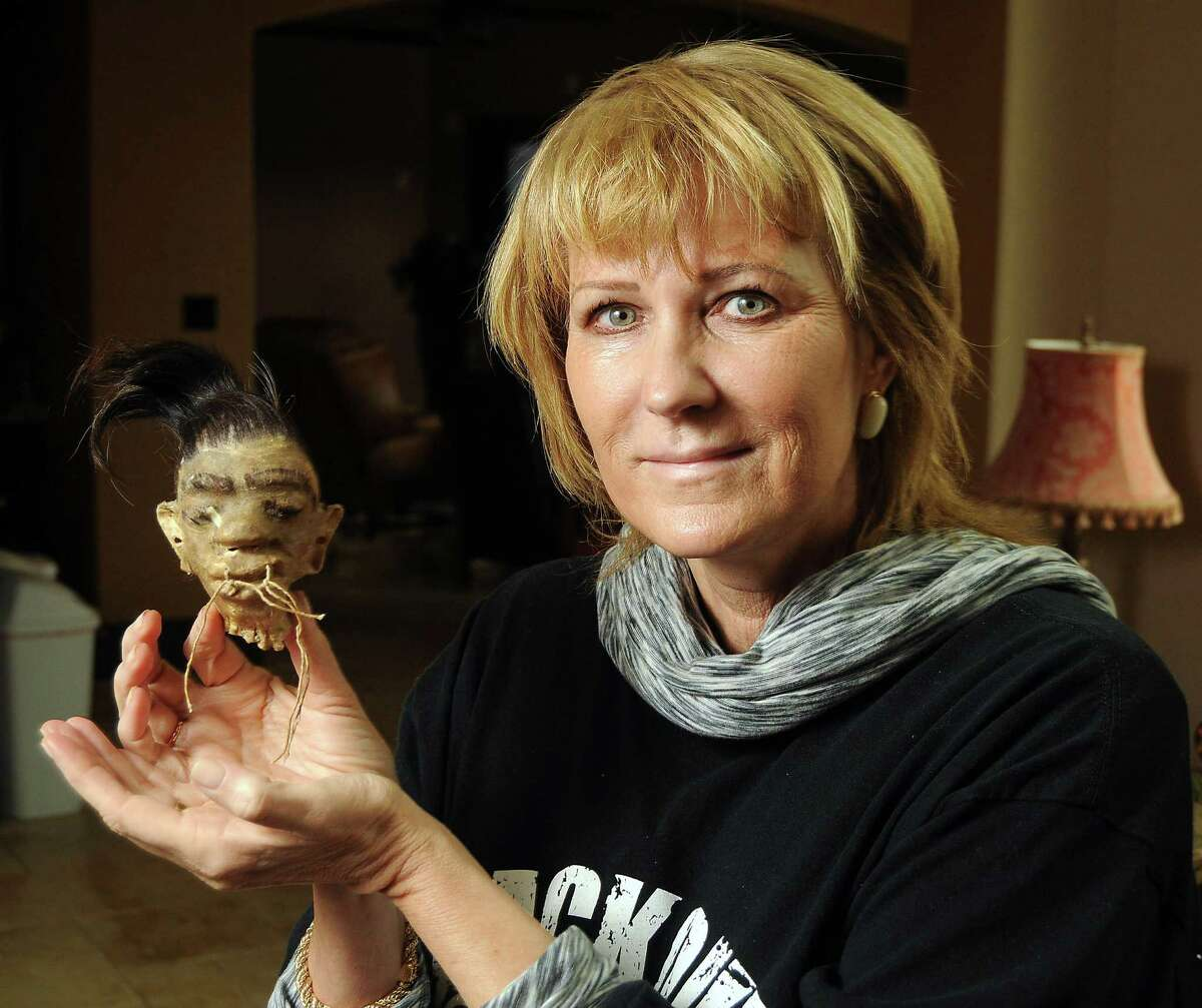 Lynn Freeman with her ugly ornament at her Katy home Saturday Dec. 14, 2013. (Dave Rossman photo)