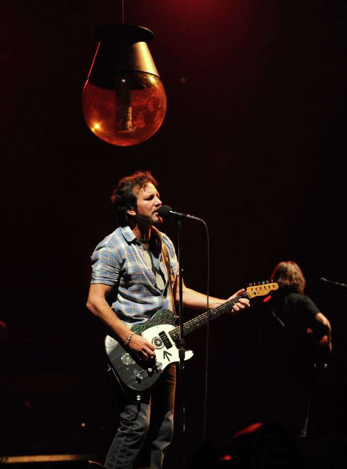 2013: Vedder about to be crushed by some sort of globe. Photo: Kevin Mazur, Getty Images / 2013 Kevin Mazur