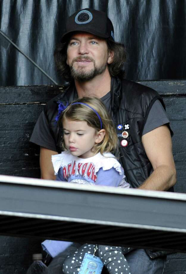 "2012: Vedder, pictured with a small child who may one day have ""Jeremy"" explained to her. Photo: Tim Mosenfelder, Getty Images / 2012 Tim Mosenfelder"
