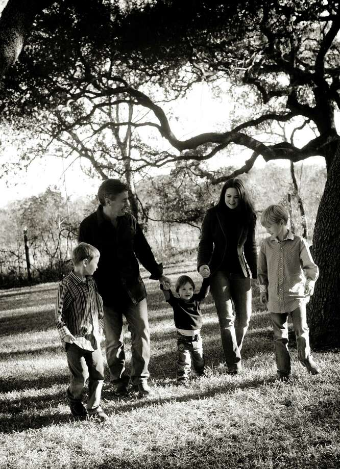 """Heather Maloy Collins, who writes the blog """"Crazy Heart Mama,"""" and her husband Kevin are the parents of three boys, Colman, left, Rowan and Liam, right."""
