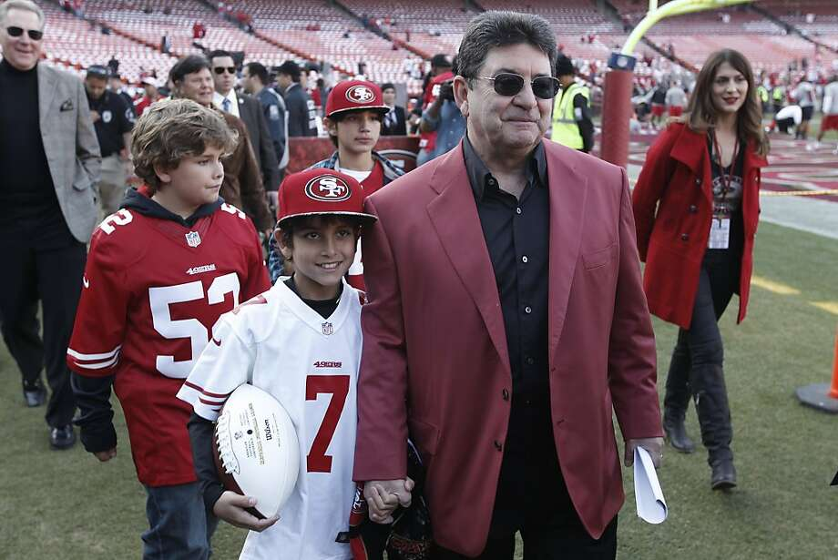 Former San Francisco 49ers owner Edward DeBartolo walks on the field with grandson, Asher Heldfond, before the game between the San Francisco 49ers and Atlanta Falcons at Candlestick Park on Monday December 23, 2013 in San Francisco, Calif. Photo: Michael Macor, The Chronicle