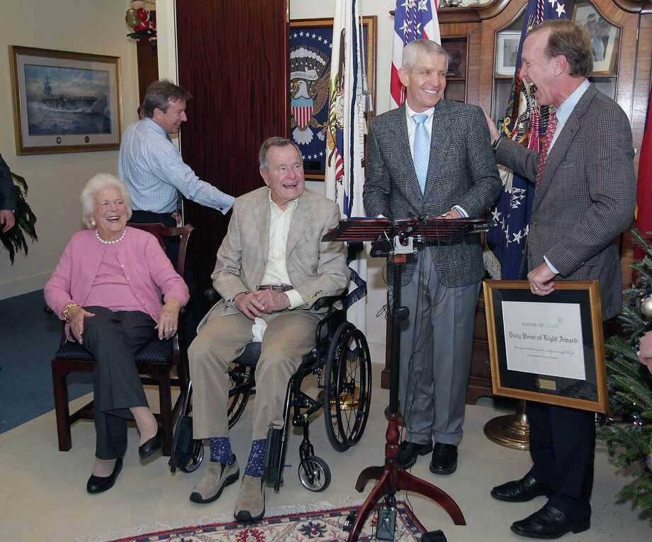 Former First Lady Barbara Bush, former President George H.W. Bush, Jim McIngvale and Points of Light Chairman Neil Bush  gather in President Bush's office to present the Point of Light Award to McIngvale. Photo: James Nielsen, Staff / © 2013  Houston Chronicle