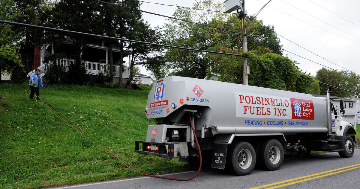 SKIP DICKSTEIN/TIMES UNION -- Oil delivery man, Mike Sleeper delivers oil to a home on Ridge Road in Rensselaer, New York September 30, 2008.