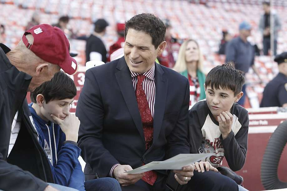 Former 49ers quarterback Steve Young talks with his sons, Braden, left, and Jackson before a game between the San Francisco 49ers and Atlanta Falcons at Candlestick Park on Monday December 23, 2013 in San Francisco, Calif. Photo: Michael Macor, The Chronicle