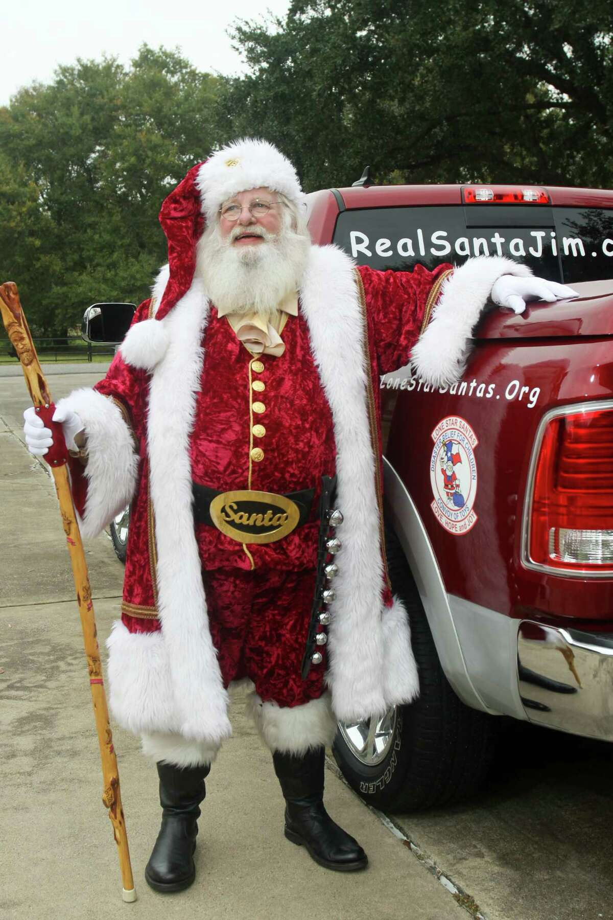 (For the Chronicle/Gary Fountain, December 20 2013) Santa Jim Fletcher dressed for work, and with his pickup, which he calls his sleigh. Jim isn't just Santa Claus in the weeks before Christmas. His white beard is year round, and during the year he attends Claus classes and conventions.