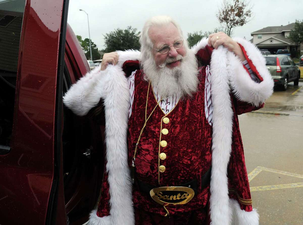 Jim Fletcher, aka Santa, gets ready for a holiday appearance. He's the founder of Lone Star Santas.