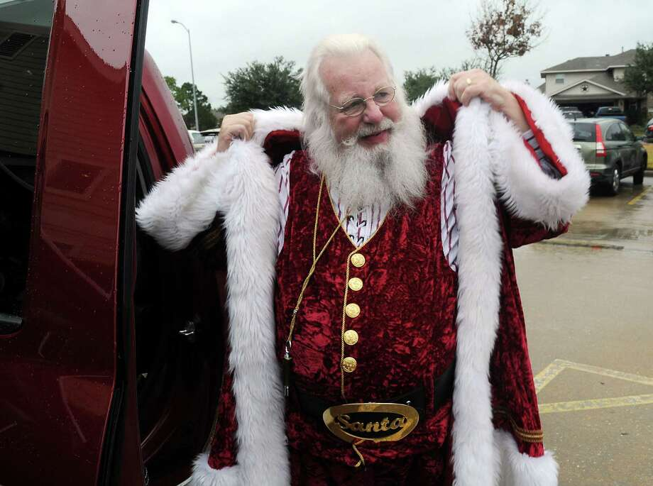 Jim Fletcher, aka Santa, gets ready for a holiday appearance. He's the founder of Lone Star Santas. Photo: Dave Rossman, Freelance / © 2013 Dave Rossman