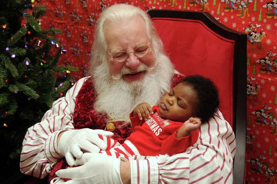 Santa Jim Fletcher gently cuddles 3-month-old Micah Cockrell at the Cypress Mill Recreation Center. Read more about him at HoustonChronicle.com Photo: Dave Rossman, Freelance / © 2013 Dave Rossman
