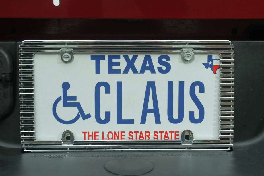 (For the Chronicle/Gary Fountain, December 20 2013) The license plate on Jim Fletcher's pickup, which he calls his sleigh. Jim isn't just Santa Claus in the weeks before Christmas. His white beard is year round, and during the year he attends Claus classes and conventions. Photo: Gary Fountain, Freelance / Copyright 2013 Gary Fountain.