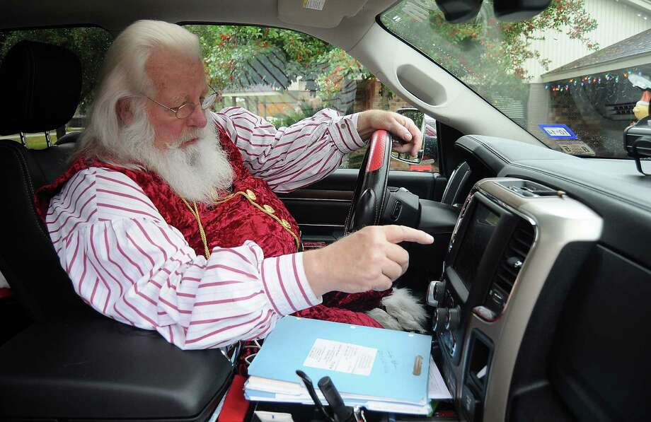 Santa Jim Fletcher programs his GPS before leaving for his appearance Saturday Dec. 21, 2013. (Dave Rossman photo) Photo: Dave Rossman, Freelance / © 2013 Dave Rossman