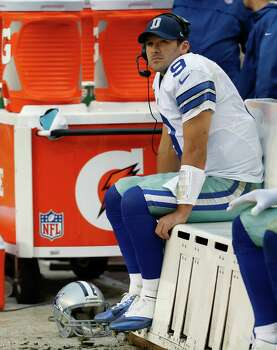 Dallas Cowboys quarterback Tony Romo seats on the beach as watches the action on the big screen television during the second half of an NFL football game against the Washington Redskins in Landover, Md., Sunday, Dec. 22, 2013. (AP Photo/Alex Brandon) Photo: Alex Brandon, Associated Press / AP