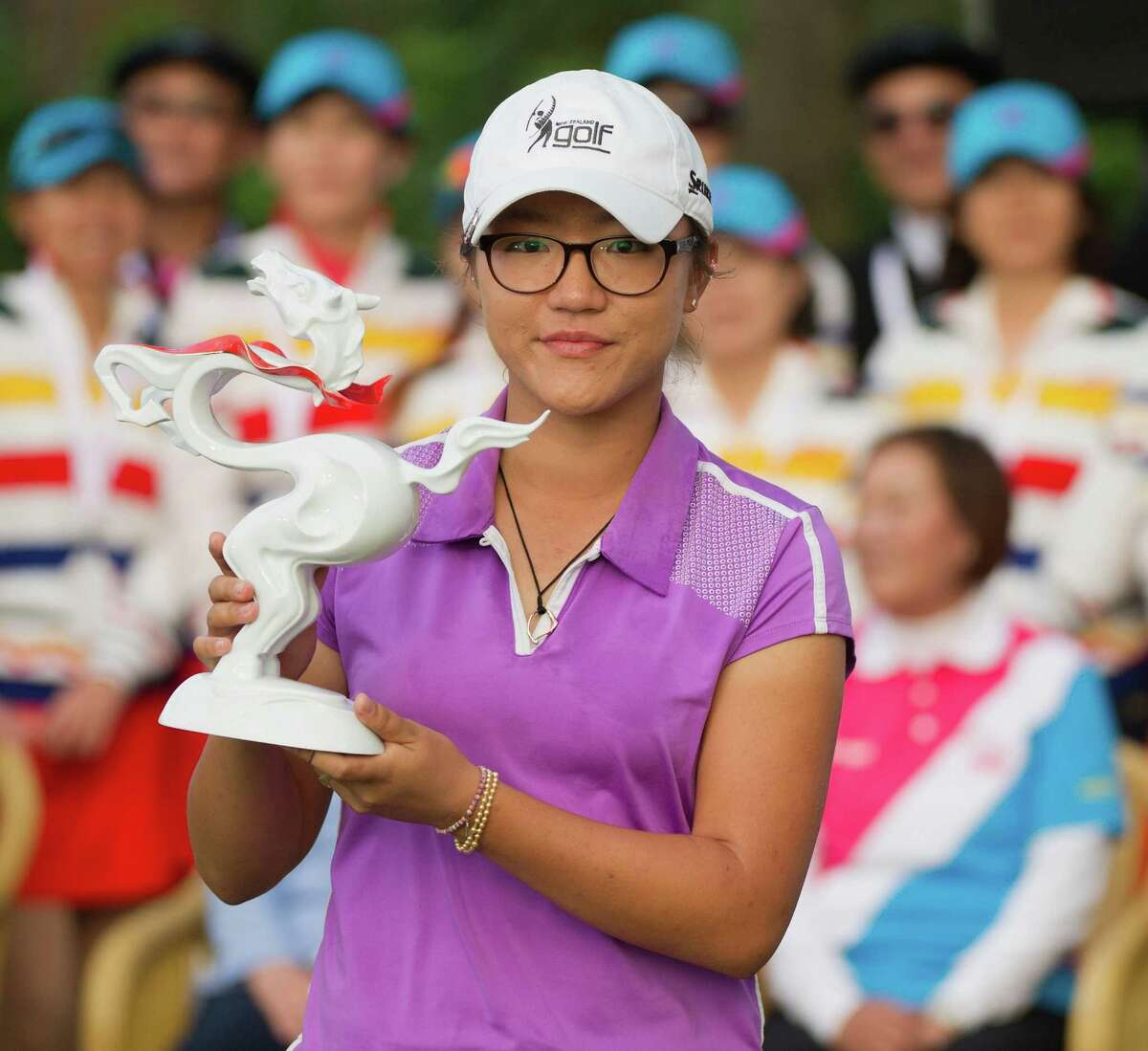 TAIPEI, TAIWAN - DECEMBER 08: Winner of the 2013 Swinging Skirts World Ladies Masters, Lydia Ko of New Zealand, holds up her trophy, during the last day of the Swinging Skirts 2013 World Ladies Masters, at Miramar Golf & Country Club on December 8, 2013 in Taipei, Taiwan. (Photo by Gareth Gay/Getty Images) ORG XMIT: 451694979