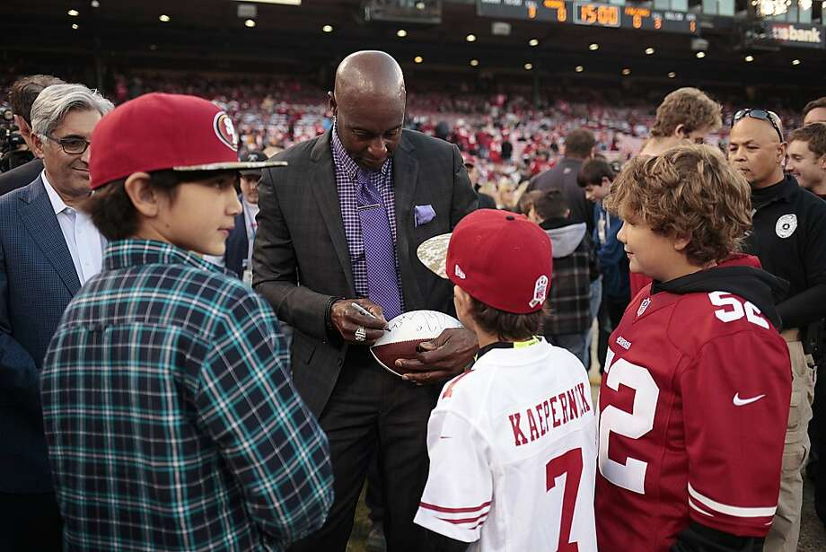 Jerry Rice signs a football for young fans at the last game at Candlestick Park on Monday, Dec. 23, 2013. The San Francisco 49ers hosted the Atlanta Falcons at one of their last games at Candlestick Park. Photo: James Tensuan, Special To The Chronicle