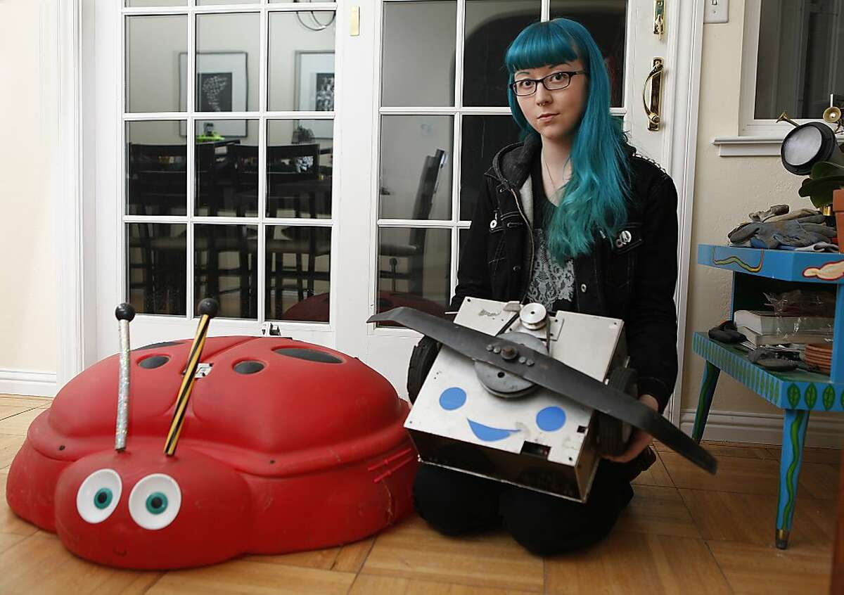 Once crowned the Robot Wars Middleweight World Champion, Lisa Winter shows robots she made for Robot Wars stored at her parent's home in Orinda, Calif., on Thursday, December 19, 2013. The ladybug called Tentoumushi (left) is a servo-mounted ladybug sandpit lid with a circular saw on the underside. The shell dropped over other robots trapping them while the saw destroyed them.