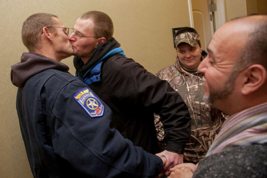 Patrick Freideman, left, and his husband Spencer Freideman kiss during their wedding in a hallway at the Hampton Inn in Ogden on Monday, Dec. 23, 2013. The Freidemans arrived at the county clerk's office on Sunday and spent the night on the sidewalk outside in order to make sure they had a chance to get married in Utah. (AP Photo/Standard-Examiner, Benjamin Zack) Photo: Benjamin Zack, MBO / Standard-Examiner