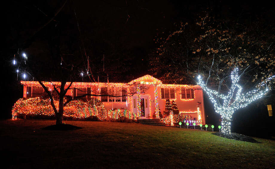 This house displays their Christmas lights along Bouton Street West in the Springdale section of Stamford, Conn. Photographed on Monday, Dec. 23, 2013. Photo: Jason Rearick / Stamford Advocate