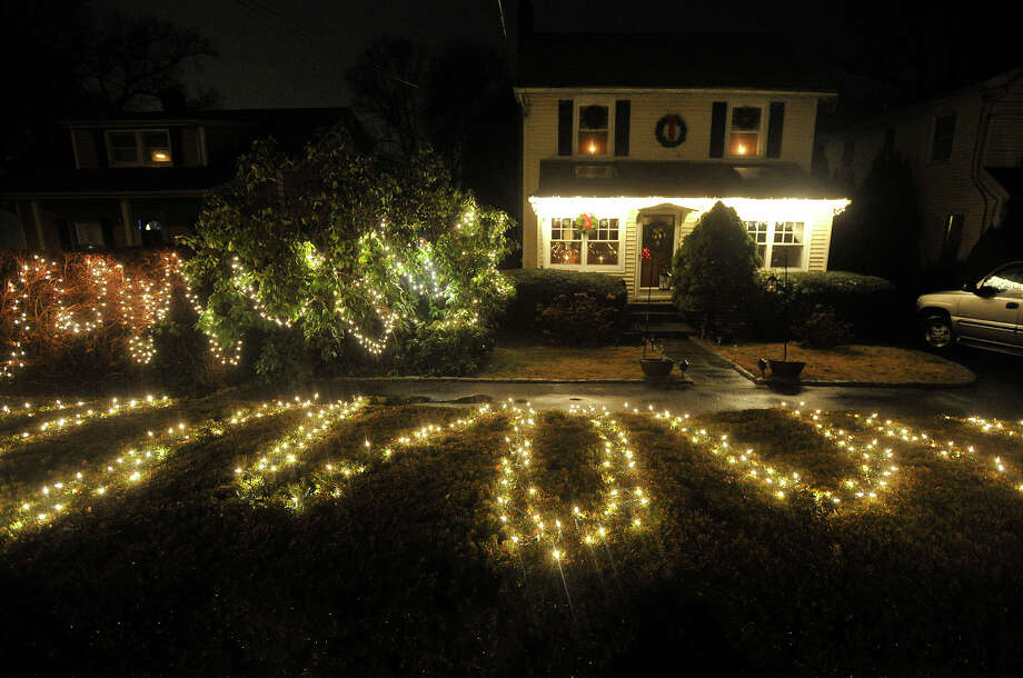 This house displays their Christmas lights along Ridgewood Avenue in the Springdale section of Stamford, Conn. Photographed on Monday, Dec. 23, 2013. Photo: Jason Rearick / Stamford Advocate