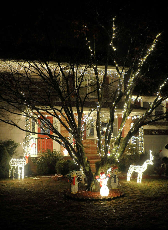 This house displays their Christmas lights along St. Charles Avenue in the Springdale section of Stamford, Conn. Photographed on Monday, Dec. 23, 2013. Photo: Jason Rearick / Stamford Advocate