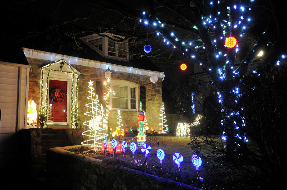 This house displays their Christmas lights along Mulberry Street in the Springdale section of Stamford, Conn. Photographed on Monday, Dec. 23, 2013. Photo: Jason Rearick / Stamford Advocate