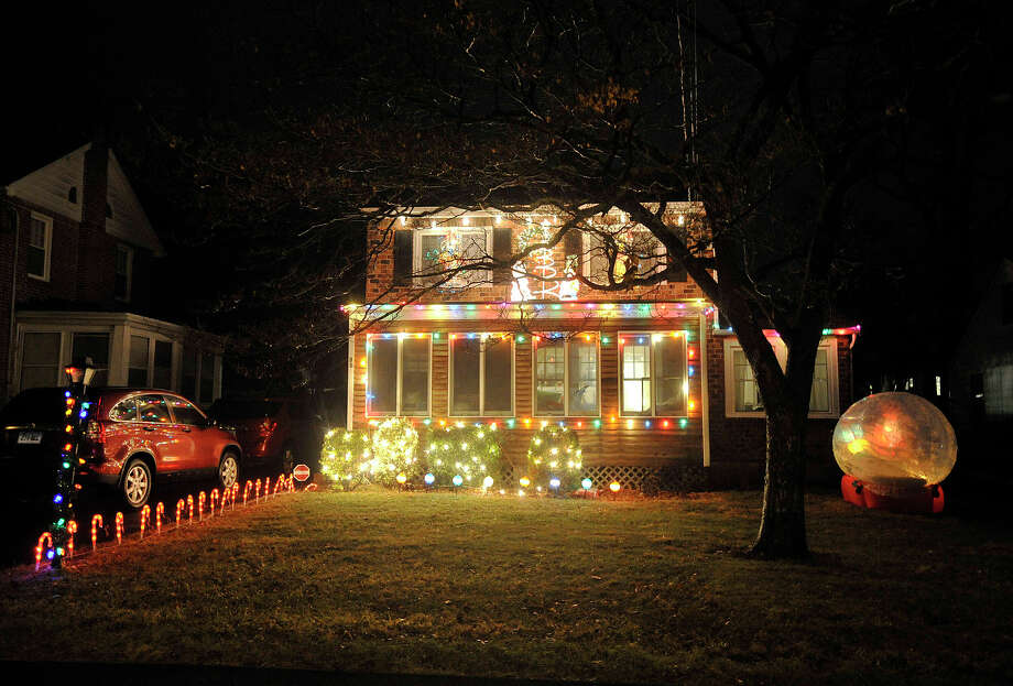 This house displays their Christmas lights along Elizabeth Avenue in the Springdale section of Stamford, Conn. Photographed on Monday, Dec. 23, 2013. Photo: Jason Rearick / Stamford Advocate