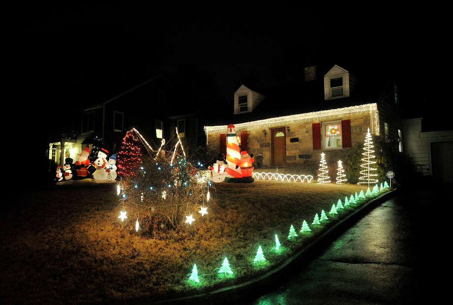 This house displays their Christmas lights along Gaymoor Drive in the Springdale section of Stamford, Conn. Photographed on Monday, Dec. 23, 2013. Photo: Jason Rearick / Stamford Advocate
