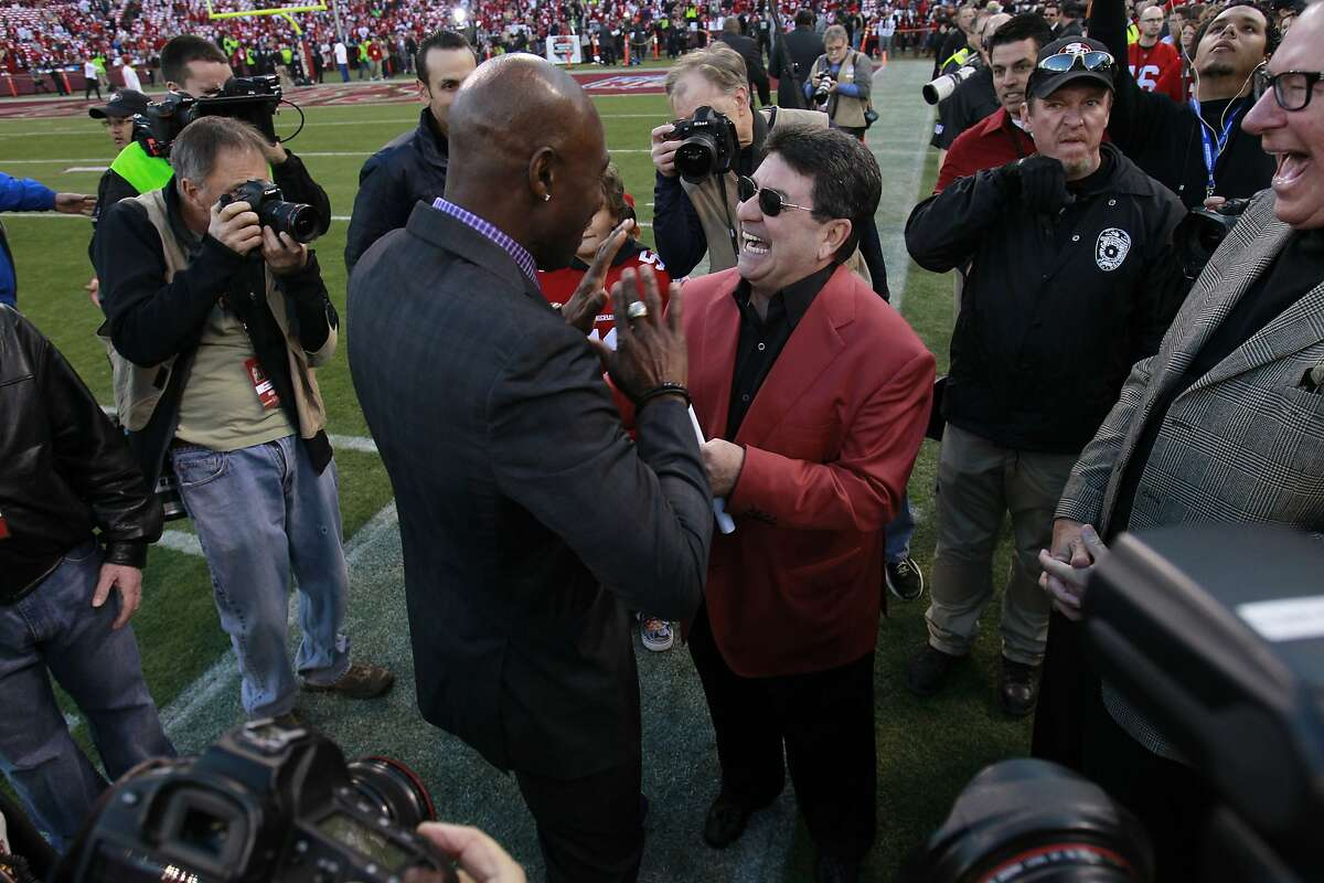 Former San Francisco 49ers wide receiver Jerry Rice talks to former San Francisco 49ers owner Edward DeBartolo before the game between the San Francisco 49ers and Atlanta Falcons at Candlestick Park on Monday December 23, 2013 in San Francisco, Calif.