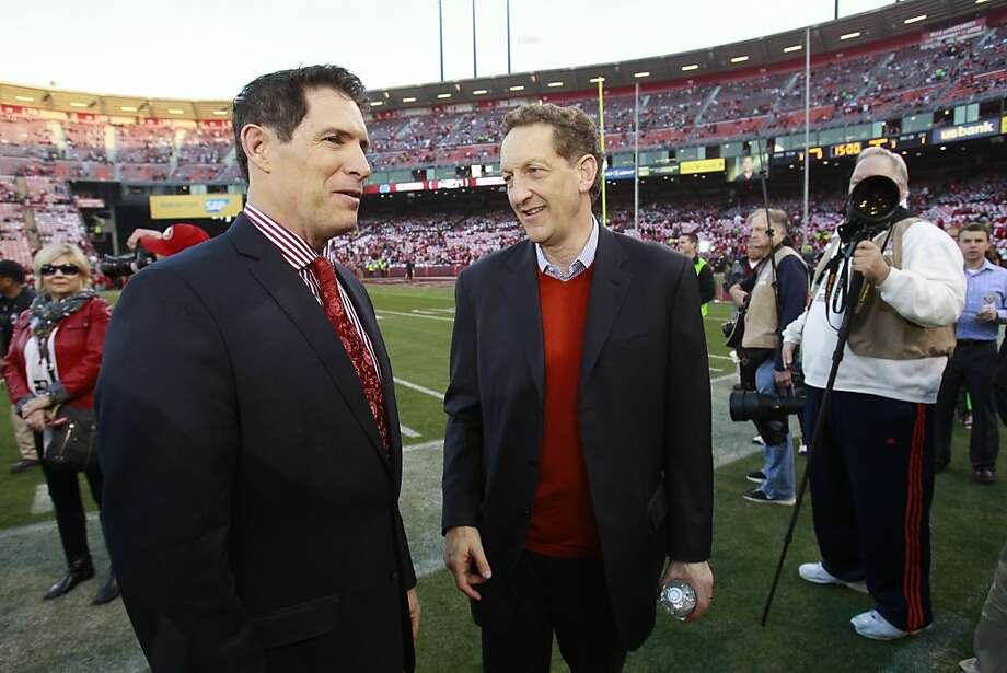 Former San Francisco 49ers quarterback Steve Young speaks with Larry Baer, CEO of the San Francisco Giants, before the game between the San Francisco 49ers and Atlanta Falcons at Candlestick Park on Monday December 23, 2013 in San Francisco, Calif. Photo: Beck Diefenbach, Special To The Chronicle