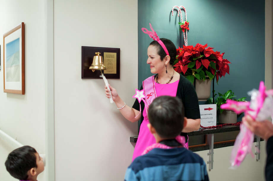 Myrna Montes rings a bell at MD Anderson Regional Care Center to celebrate the end of her radiation treatment. Photo: Provided By MD Anderson Regional Care Center