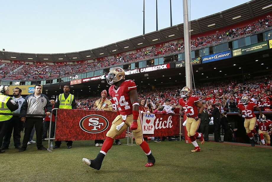 San Francisco 49ers running back Anthony Dixon (24) and San Francisco 49ers running back LaMichael James (23) run onto the field before the game between the San Francisco 49ers and Atlanta Falcons at Candlestick Park on Monday December 23, 2013 in San Francisco, Calif. Photo: Beck Diefenbach, Special To The Chronicle