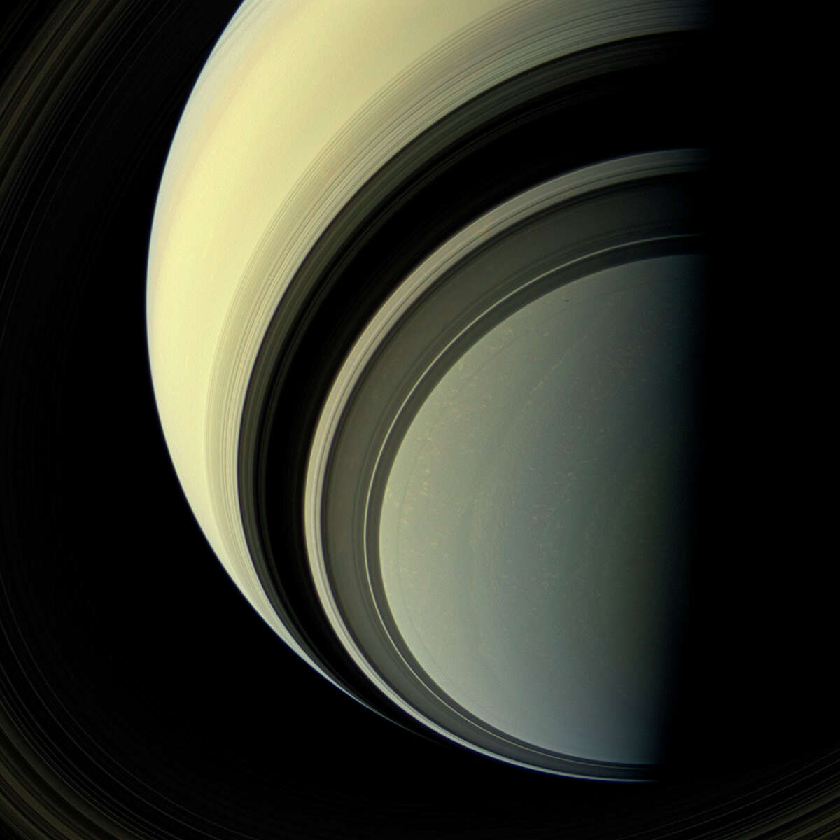 This July 29, 2013 image provided by NASA shows that Winter is approaching in the southern hemisphere of Saturn and with this cold season has come the familiar blue hue that was present in the northern winter hemisphere at the start of NASA's Cassini mission. This view looks toward the non-illuminated side of the rings from about 44 degrees below the ring plane. Images taken using red, green and blue spectral filters were combined to create this natural color view. The images were taken with the Cassini spacecraft wide-angle camera. The Cassini-Huygens mission is a cooperative project of NASA, the European Space Agency and the Italian Space Agency. (AP Photo/NASA/JPL-Caltech/Space Science Institute) ORG XMIT: LA113