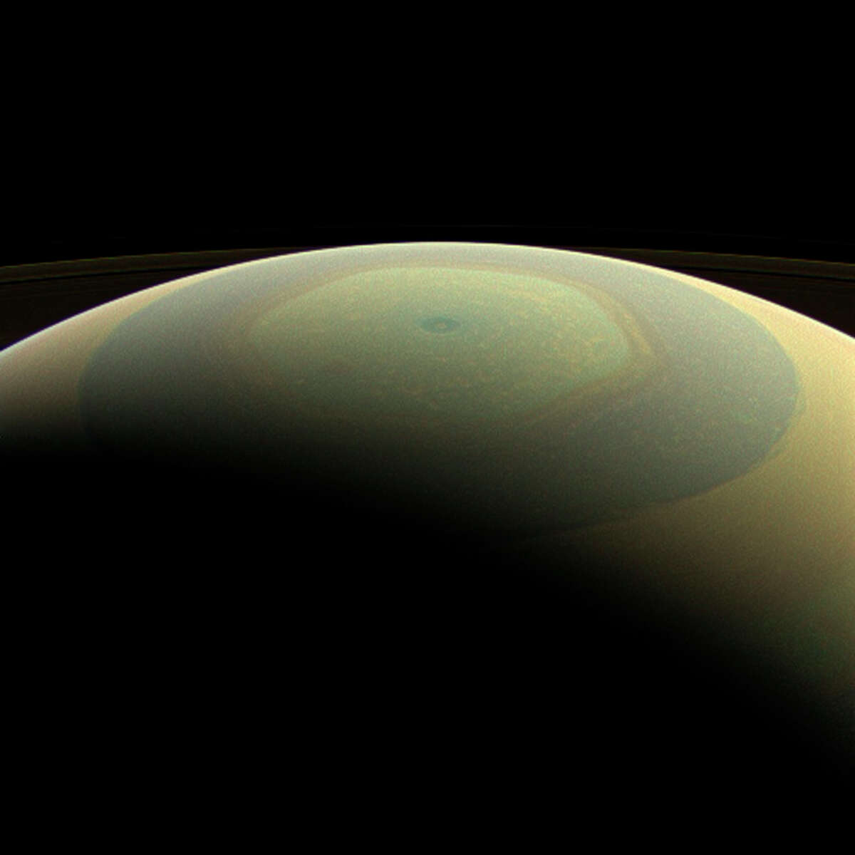 This July 22, 2013 image provided by NASA shows the globe of Saturn, seen here in natural color, in this wide-angle view from NASA's Cassini spacecraft. The characteristic hexagonal shape of Saturn's northern jet stream, somewhat yellow here, is visible. At the pole lies a Saturnian version of a high-speed hurricane, eye and all. This view is centered on terrain at 75 degrees north latitude, 120 degrees west longitude. Images taken using red, green and blue spectral filters were combined to create this natural-color view. The images were taken with the Cassini spacecraft wide-angle camera. (AP Photo/NASA/JPL-Caltech/Space Science Institute) ORG XMIT: LA112