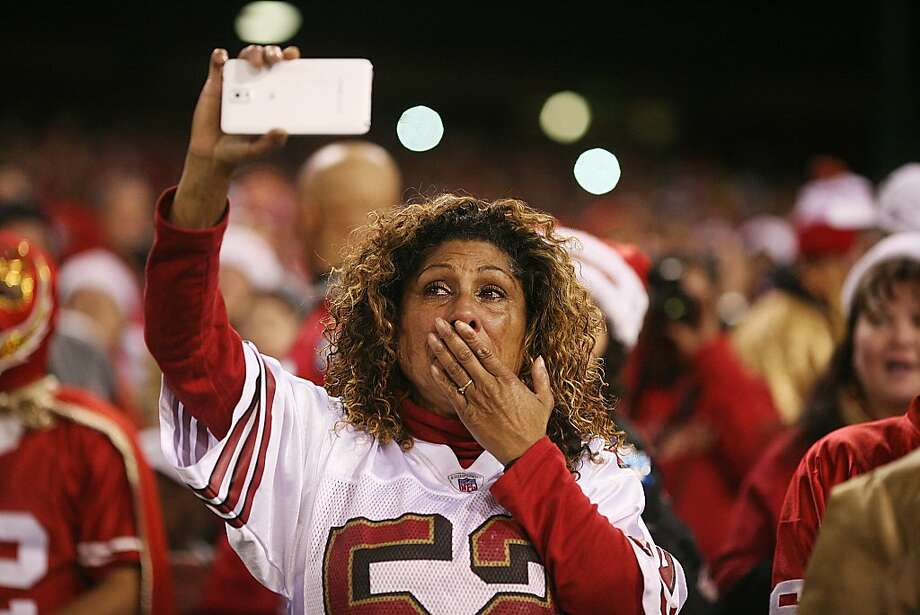 A fan cries as the San Francisco 49ers take to the field on Monday, Dec. 23, 2013. The San Francisco 49ers hosted the Atlanta Falcons at one of their last games at Candlestick Park. Photo: James Tensuan, Special To The Chronicle
